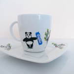 """Filiżanka """"Panda z batonikiem Milky Way"""""""